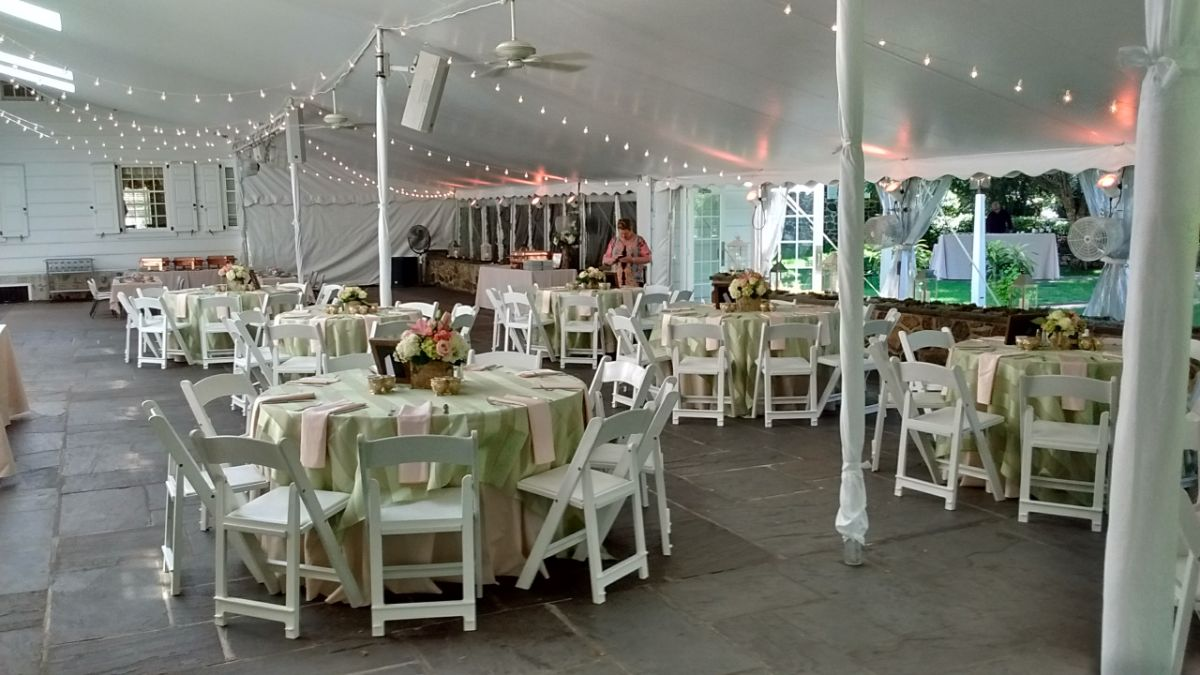 tables decorated with center pieces for a special event